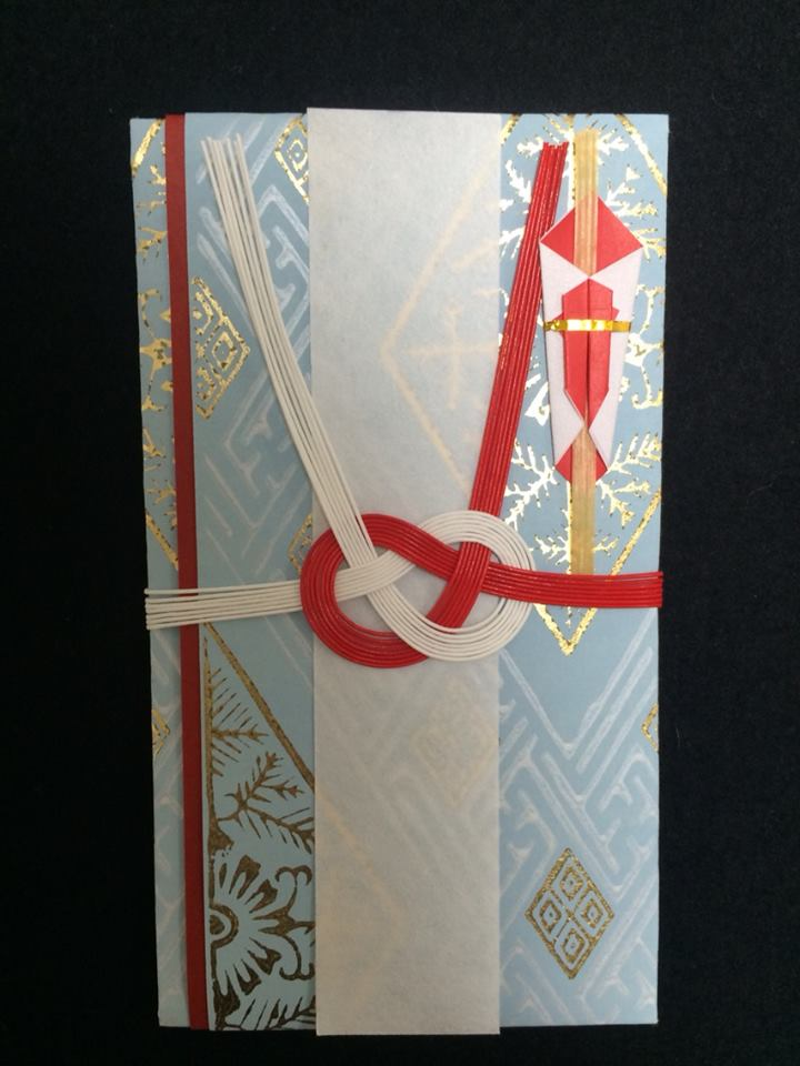 a special envelope for presenting a monetary gift or a tip